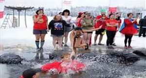 Annual Winterfest: Over 1,000 take plunge in icy lake