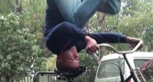 Chinese Youngster Exhibits Riding Bicycle Upside Down