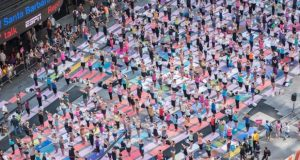 Over 12,000 People Exhibit Yoga in Times Square
