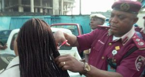 Nigerian official gives haircuts, sparks outrage