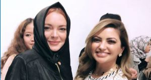 London: Lindsay Appears in Hijab at Fashion Show